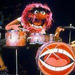 Animal from the Muppets plays the drums.