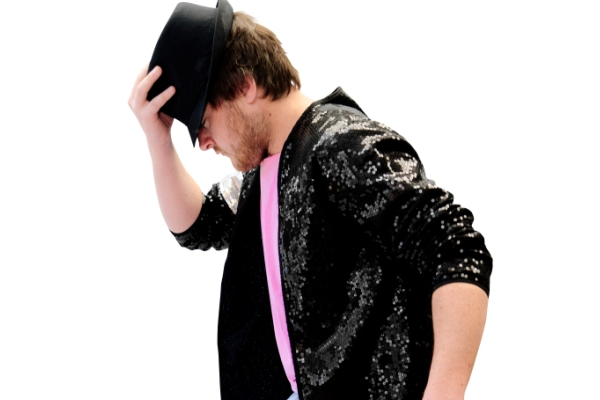 An image of The 80's Flashback lead vocalist, Nick, wearing a Michael Jackson style hat and sequined jacket